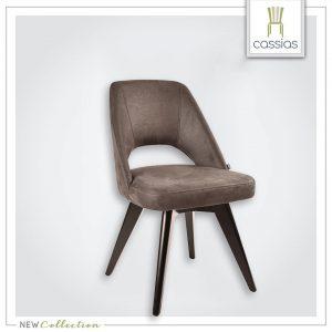 כסא מרופד בבד במראה דמוי עור